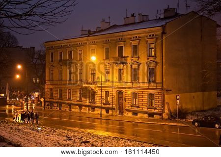 Old historic building in old town. The building contains bookshop and library owned to Roman Catholic Archdiocese of Krakow. Poland.