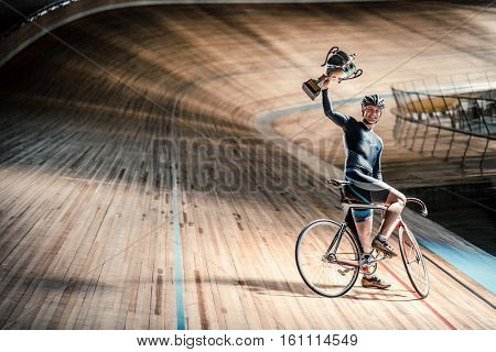 Young sportsman on a velodrome