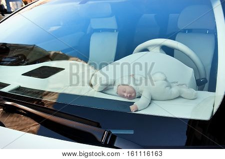 Doll baby dressed a bunny rabbit in the car