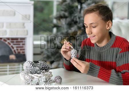 Portrait of teen boy preparing for Christmas at home