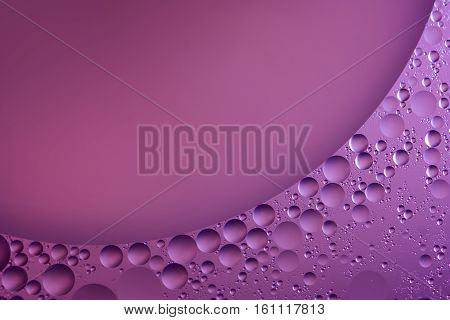 Abstract water bubbles light illumination background, art of water bubbles on water surface background. Abstract glare on bubbles and watery background