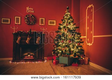 Beautiful New Year Room With Decorated Christmas Tree, Gifts And Fireplace A Night With Of Glowing L