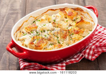 White fish casserole with cheese, sour cream and onion
