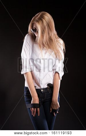 Sensual Woman In White Shirt And Jeans. Wearing Sunglasses And Suspenders