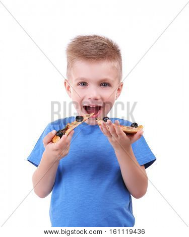 Cute boy eating pizza, isolated on white