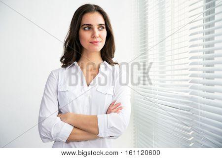 Portrait of a business woman against a window