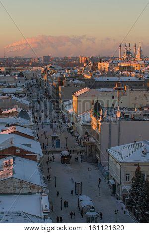 KAZAN, RUSSIA - DECEMBER 11, 2016: center of Kazan - old orthodox church, kremlin, mosque Kull Shariff, Bauman street. Winter sunset telephoto