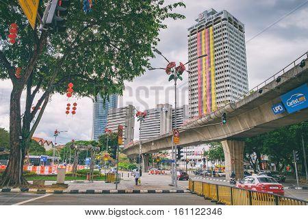 Kuala Lumpur, Malaysia - February 7, 2016: Cityscape with modern building in the city centre Jalan Tun Perak, Kuala Lumpur, Malaysia. It is a tourist center with landmark hotels shops restaurants