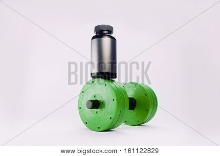 dumbbells and nutritional supplements for bodybuilding. sports nutrition