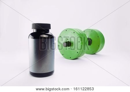 dumbbells and nutritional supplements for bodybuilding. sports nutrition.