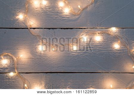 Christmas festoon on wooden floor