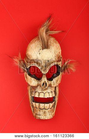 Wooden Carved Skull Death Mask On Red
