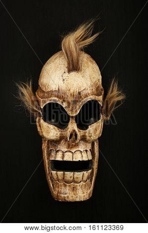 Wooden Carved Skull Death Mask On Black