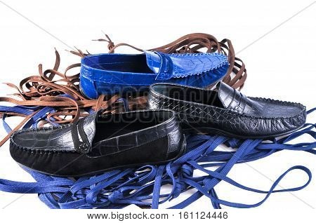 Men's leather loafers (moccasins) isolated on a background of colored laces