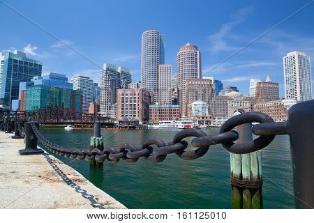 BOSTON , MASSACHUSETTSUSA - JULY 15, 2016: Boston skyline and Northern Avenue Bridge. Built in 1908 it was closed to vehicle traffic in 1999