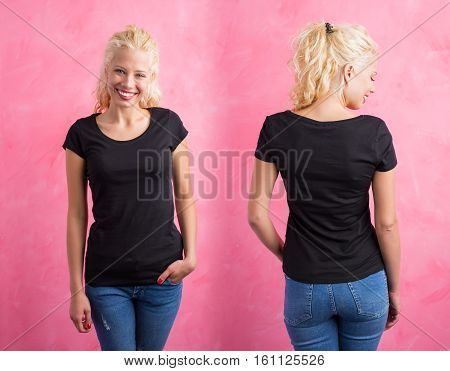 Woman in black round neck T-shirt on pink background