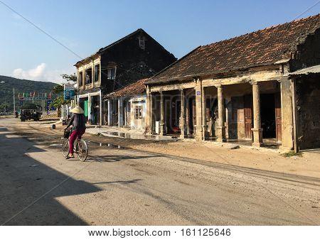 Asian Woman Biking At The Ancient Town