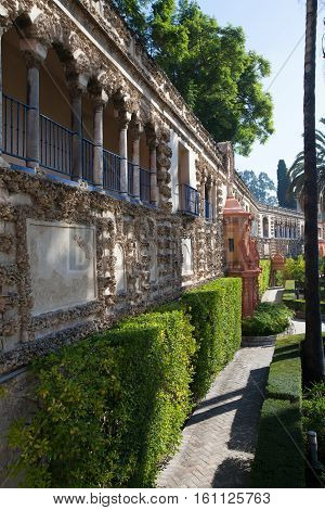 Seville Spain - November 18 2016: Real Alcazar Gardens in Seville.The Alcazar of Seville is a royal palace in Seville Spain originally developed by Moorish Muslim kings.