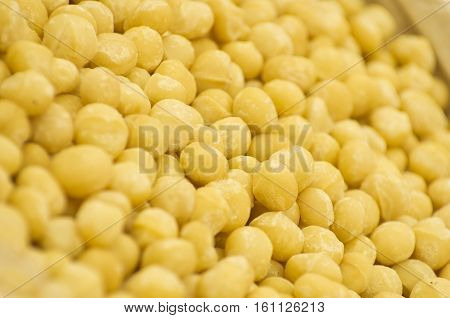 Close up large quantity heap lentils for sale supermarket.