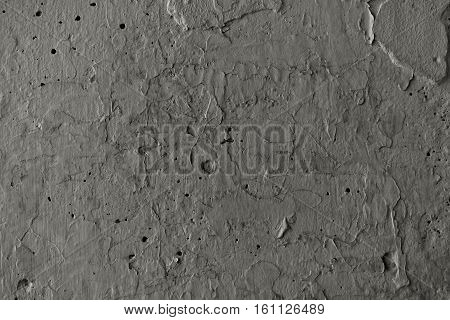 Plaster, gray plaster on a concrete wall. Stucco gray wall background or texture. Plaster, plaster texture, plaster background. Gray wall, gray background.