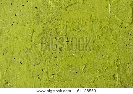 Lemon-colored stucco on a concrete wall. Stucco  lemon-colored wall background or texture. Plaster, plaster texture, plaster background. Lemon-colored wall, lemon-colored background. Color plaster.