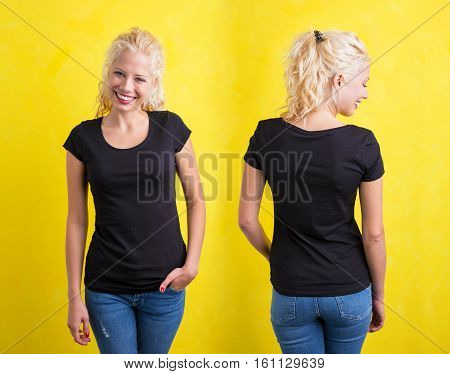 Woman in black round neck T-shirt on yellow background