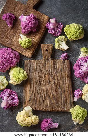 Rainbow Of Organic Cauliflower And Romanesco Broccoli On Wooden