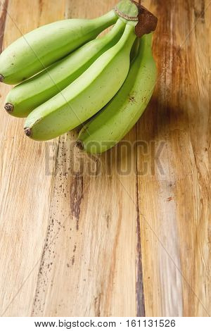 Bunch  Ripe Green Bananas. Yellow Leaves Of A Banana Tree Backgr