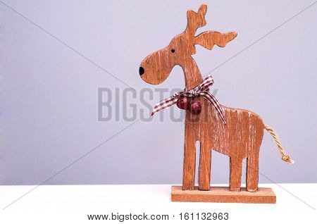 Decorative Christmas elk on a light background