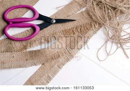 a brown scissors and grain sacking linen, hand made