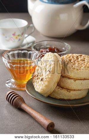 Hot Home Made Toasted Crumpets Served With Honey And Jams. Dark