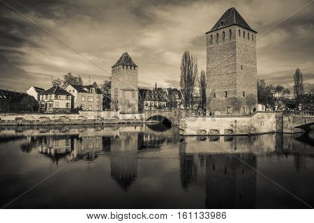 Black and white view of medieval bridge Ponts Couverts from the Barrage Vauban in Strasbourg