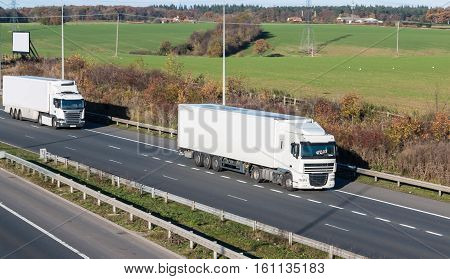 Two lorries in motion on the british motorway