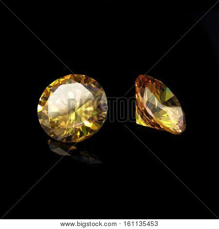 Yellow Diamond Cut Gems on a Black Background.