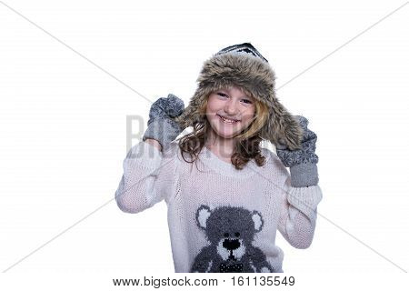 Happy Cute Kid Posing In The Studio. Wearing Winter Clothes. Knitted Woolen Sweater And Mittens. Ear
