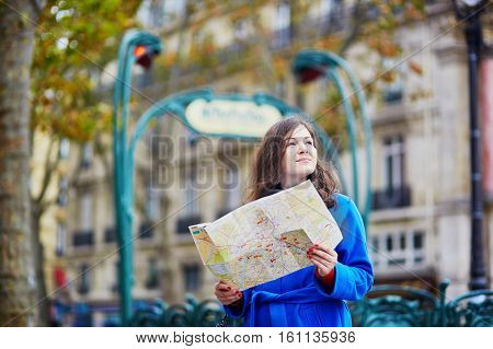 Beautiful Tourist In Paris On A Fall Day, Using Map