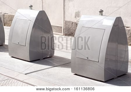 Litter bins made of metal for recycling in the centre of Florence, Italy