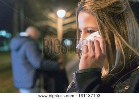 Betrayal. Upset crying girl discovering her boyfriend with another woman poster
