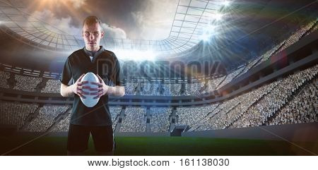 3D Rugby player holding a rugby ball against rugby stadium