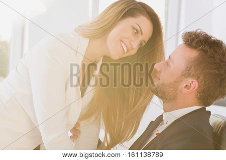 Couple Smiling In The Office