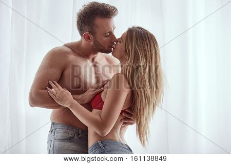 Sexy Man And Woman Kissing