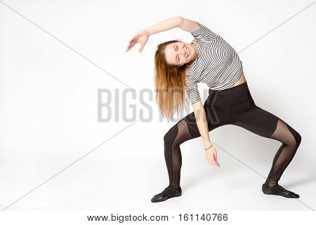 Woman In Sportswear Standing On Extended Triangle Pose Or Trikonasana, Bent Sideways With One Hand T