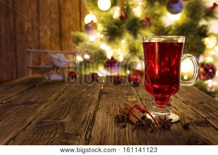 Christmas Mulled Wine In Glass Cup On A Wooden Table