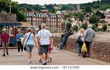Minehead UK - July 27 2016: People walking and enjoying a summer day in a shoreside in Minehead UK.