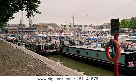 Bristol UK - July 16 2016: Moored boats at the Bristol Harbour Festival in the Historic Harbour. Bristol. Avon. With crowds of people