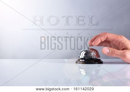 Customer Ringing The Bell Hotel Service With Placard Front View