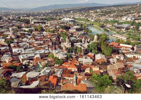 Cityscape of the historical center of Tbilisi with medieval churches and river Kura, Georgia country