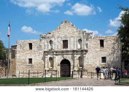 SAN ANTONIO TEXAS - AUGUST 22 2015: Tourists line up to visit The Alamo in San Antonio Texas USA on August 22 2015.