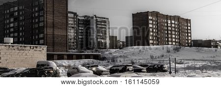 Dark winter landscape. Grunge urban background. Apartment buildings. Municipal housing. Housing complex. Grunge landscape