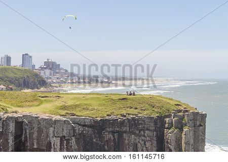 People Over Cliffs And Paraglider In Torres Beach
